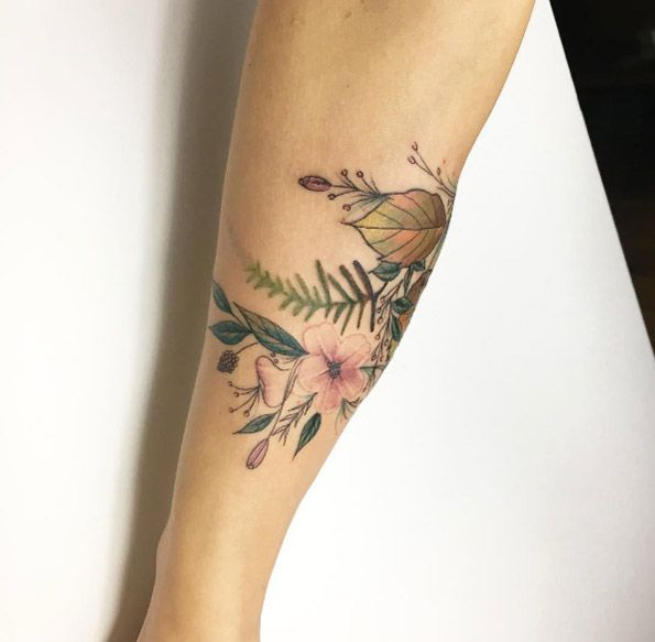 Floral forearm tattoo by Fatih Odabas