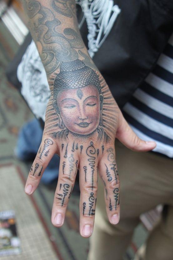 Buddha hand tattoo..cool spirals.