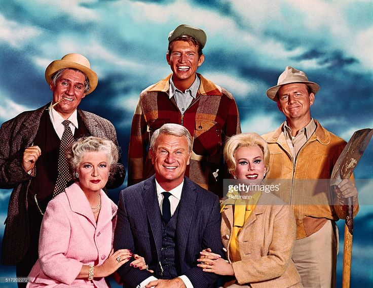 Publicity photo of the cast of Green Acres left to right: Pat Buttram as Mr. Haney, and Tom Lester as Eb Dawson, Alvy Moore as Hank Kimball (seated), Elenor Audley as Lisa's Mother, Eddie Albert as Oliver Douglas and Eva Gabor as Lisa Douglas.
