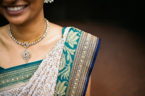 The neat folding and arranging of this bride's sari pleats is perfect.