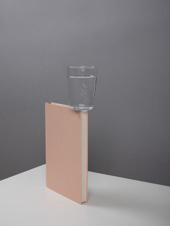 Glass on book by Csilla Klenyánszki