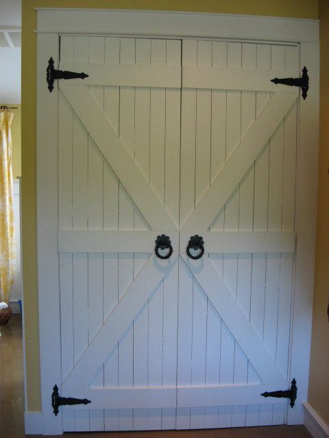 I love this idea for closet doors. This would be great for our bedroom. I think I want them more rustic though.