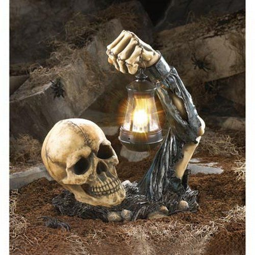 Scary Outside Halloween Decorating Ideas: This Sinister Skull With Lantern Will Give Guests A
