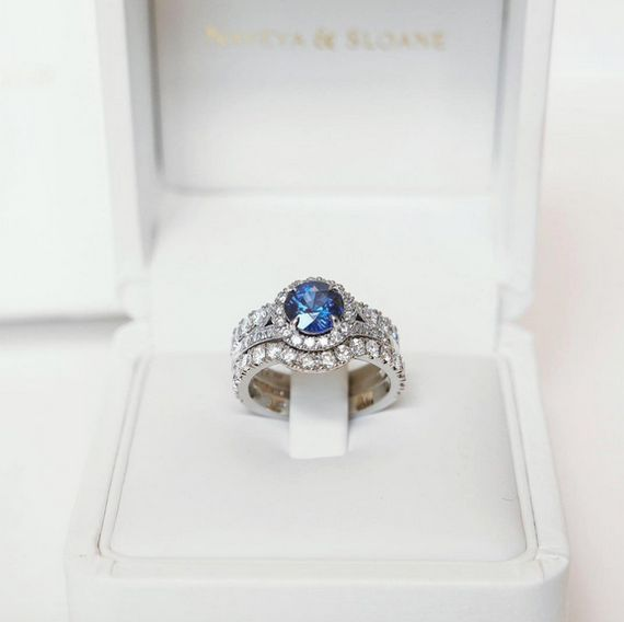 Naveya & Sloane bespoke claw set diamond fitted wedding band. Crafted in platinum, the wedding bands were designed to fit either side of The Sol Setting, shown here in platinum with a sapphire centre stone.