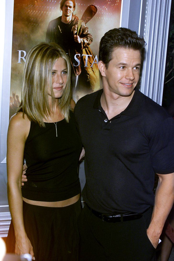 Pin for Later: Birthday Girl Jennifer Aniston's Got More Famous Friends Than We Can Count  Jennifer posed with Mark Wahlberg at the September 2011 premiere of Rock Star in LA.