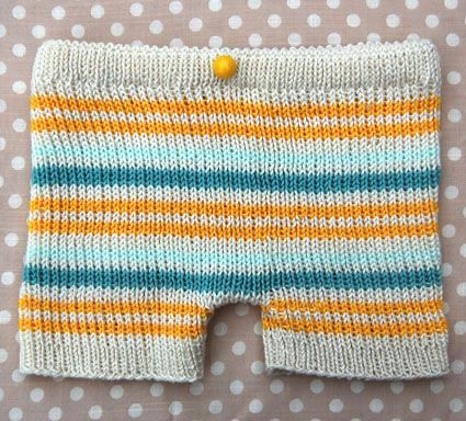 Knitted shorts pattern for baby/toddler. This pattern calls for knitting each leg before joining and going up the body, and sewing in elastic at the waist band.