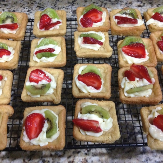 White chocolate cream cheese tarts.  Ore made sugar cookie dough Philadelphia white chocolate indulgence Fruit of your choice  Bake cookies in Pampered Chef square brownie pan - 10-12 minutes Cool and add topping and fruit.