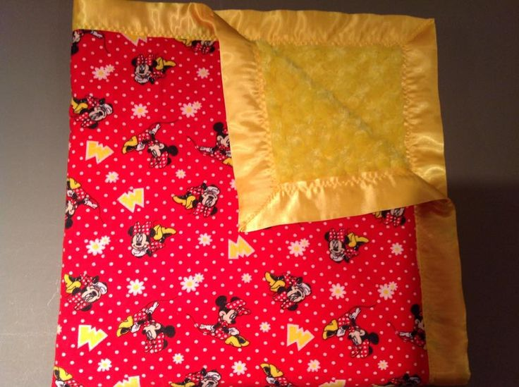 Red Minnie Mouse blanket with yellow rose and yellow trim. 36x36""