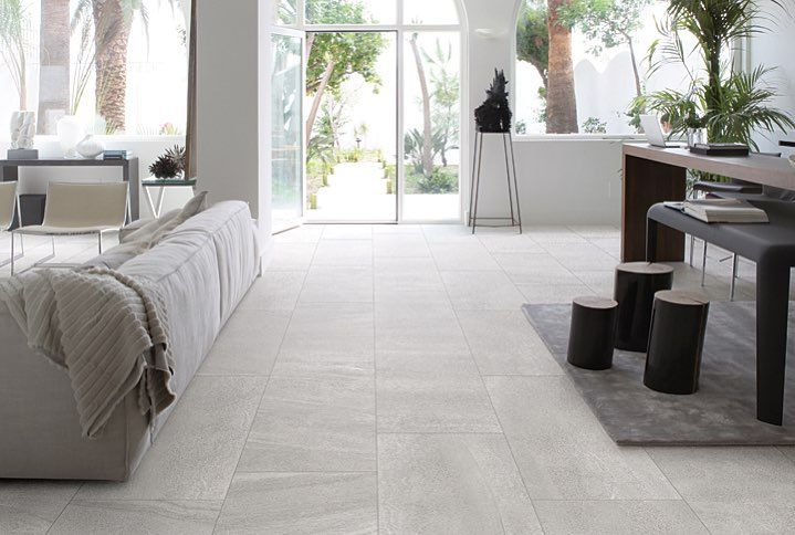 A living room you won't want to leave featuring our Olympia Tile Eco-Stone tile.
