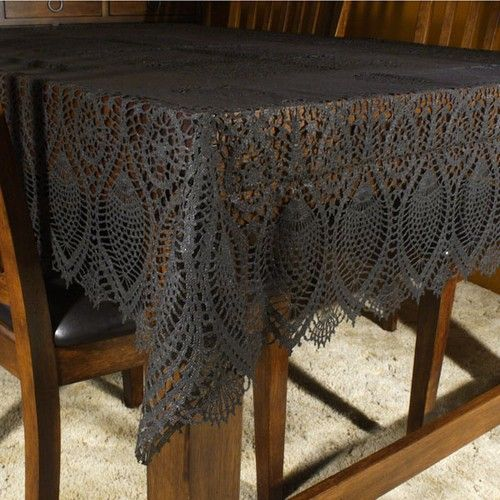 black vinyl lace tablecloth for the glamping picnic table put over a cheap white paper halloween tableclothrental decoratinglace
