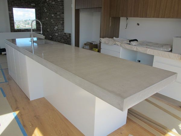 4m x 1m x 0.1m Concrete benchtop island with formed sink and overhang for breakfast bar