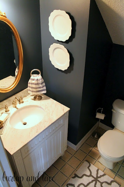 Navy blue walls white gold for Blue and gold bathroom ideas