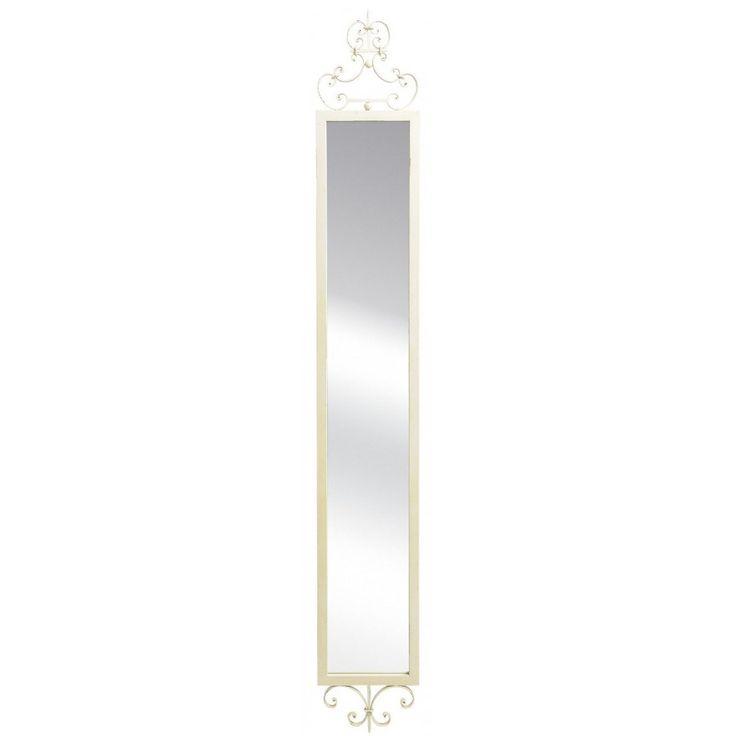 Wąskie lustro francuskie z serii Wenecja Belldeco o kremowej ramie wykonanej z metalu. Rama ta jest celowo postarzana poprzez subtelne, ciemniejsze plamki oraz przetarcia farby. W górnej i dolnej części ramy znajduje się fantacyjny ozdobnik.