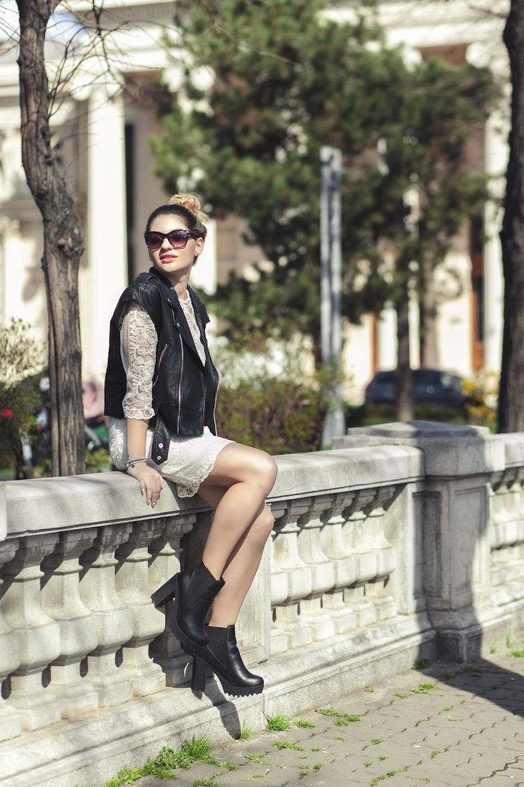 White lace dress and leather vest http://www.lauramusuroaea.com/home/white-lace