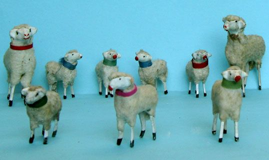 Some sheep with papier-maché head, wooden feet and cotton fur;  the small ones ca 5cm high and the larger 9cm high;   they are not only used for nativities, but also used in toy farms