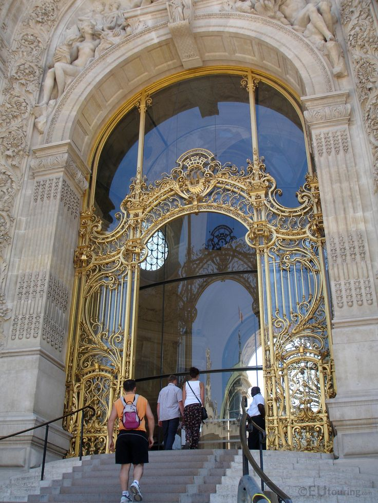 This photo shows a close up of the intricate wrought iron and gilded entrance of the Petit Palais, showing just how much detail has gone into the large doors, which was open to visitors in 1900.  More information and details at www.eutouring.com