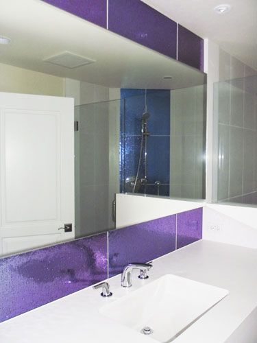 nyc bathroom with modono color changing glass accents pattern griante color blue grotto