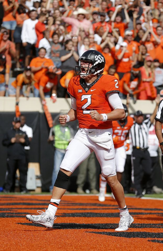 Oklahoma State's Mason Rudolph (2) celebrates a touchdown in the third quarter during a college football game between the Oklahoma State University Cowboys (OSU) and the West Virginia Mountaineers (WVU) at Boone Pickens Stadium in Stillwater, Okla., Saturday, Oct. 29, 2016. Oklahoma State won 37-20. Photo by Sarah Phipps, The Oklahoman