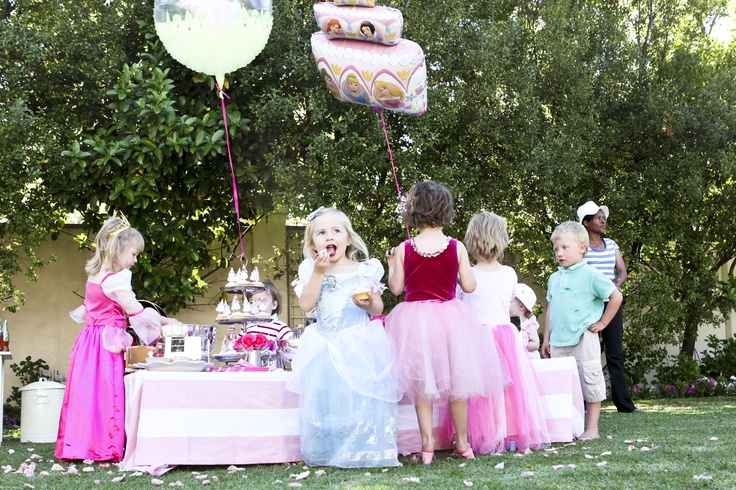Easy-to-reach table decorated with balloons and sprinkled with petals