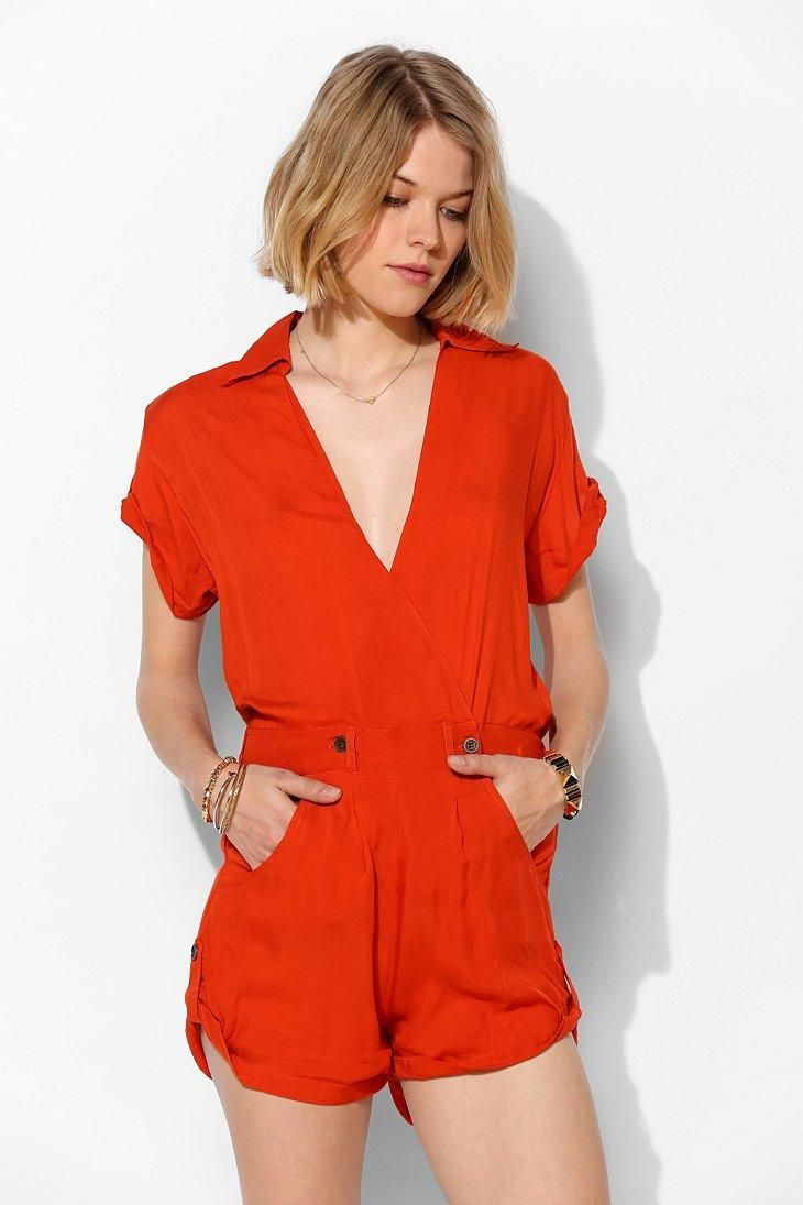 Tallow Red Riot Surplice Romper #urbanoutfitters  Yeah it's form Urban butt...... I dig it. And I have the same hair cut. Cept mines cooler.