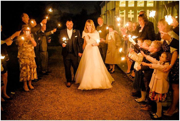 The bride and groom begin their sparkler walk. #weddingphotography #elvetham #sparklers