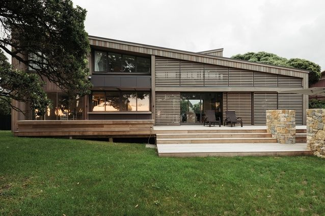 The horizontal screens contrasts with the vertical cedar cladding and provides mass to the lower part of the façade.