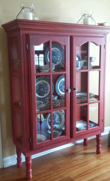 Repurposed top of hutch into Red distressed cabinet. Added legs and new pulls.