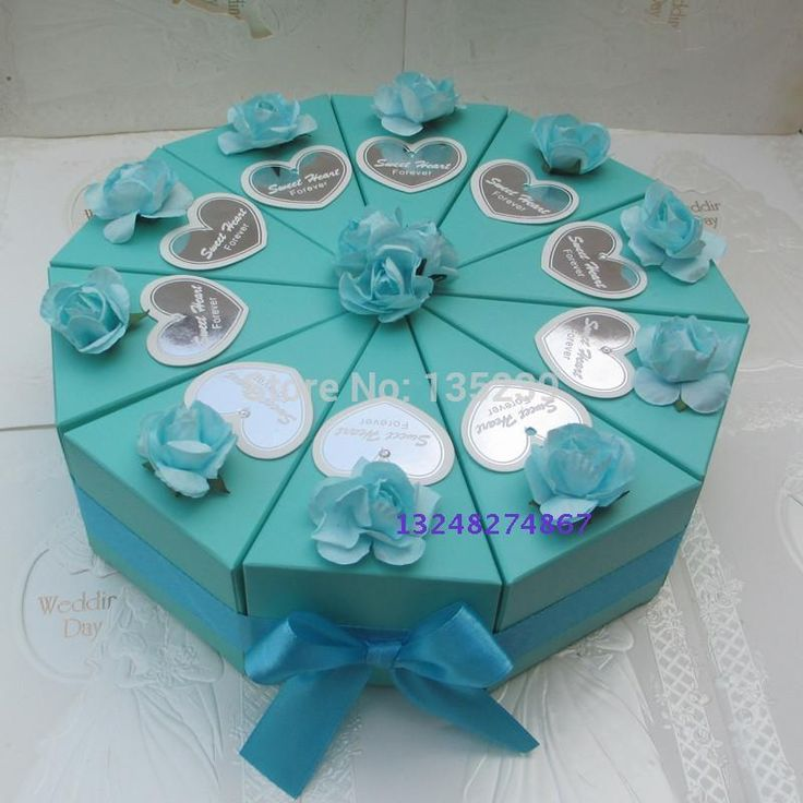 Favor boxes for guests created in the shape of a cake that can sit in the center of each table.