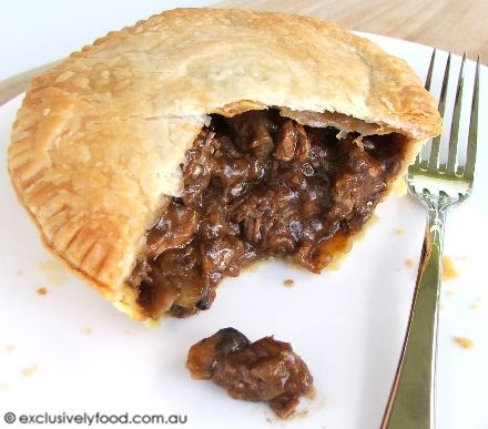 Beef and Mushroom Pie Recipe _ A shortcrust pastry base and flaky puff pastry lid enclose a moist and tender beef and mushroom filling. This recipe is an adaptation of our meat pie recipe: we've added mushrooms and thyme and increased the amount of red wine.