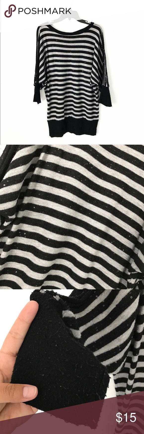Strip sequence top Black and grey strip batwing top with sequence. Used, but still in great condition. Third picture shows that it has lint balls at the end of sleeve and the bottom of the shirt. Forever 21 Tops Blouses