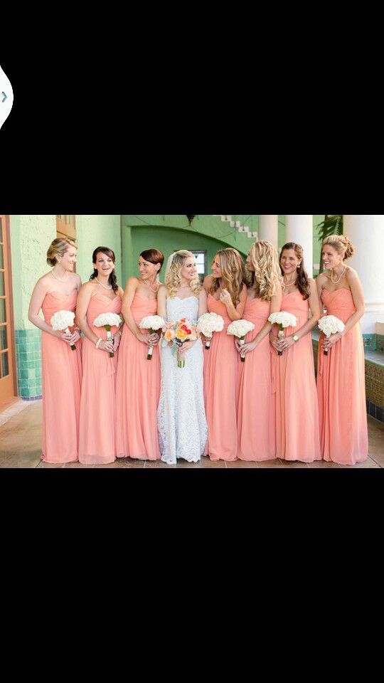 Peach/salmon colour bridesmaid dresses reflects and young and cheerful atmosphere on your wedding day.