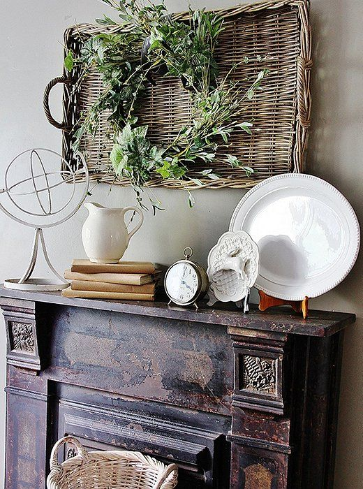 For French country or shabby-chic interiors, we love a woven tray or basket hung above the fireplace!