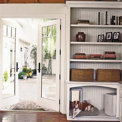 A built-in bookcase, complete with doggie door and bed! |  Photo: Dominique Vorillon thisoldhouse.com