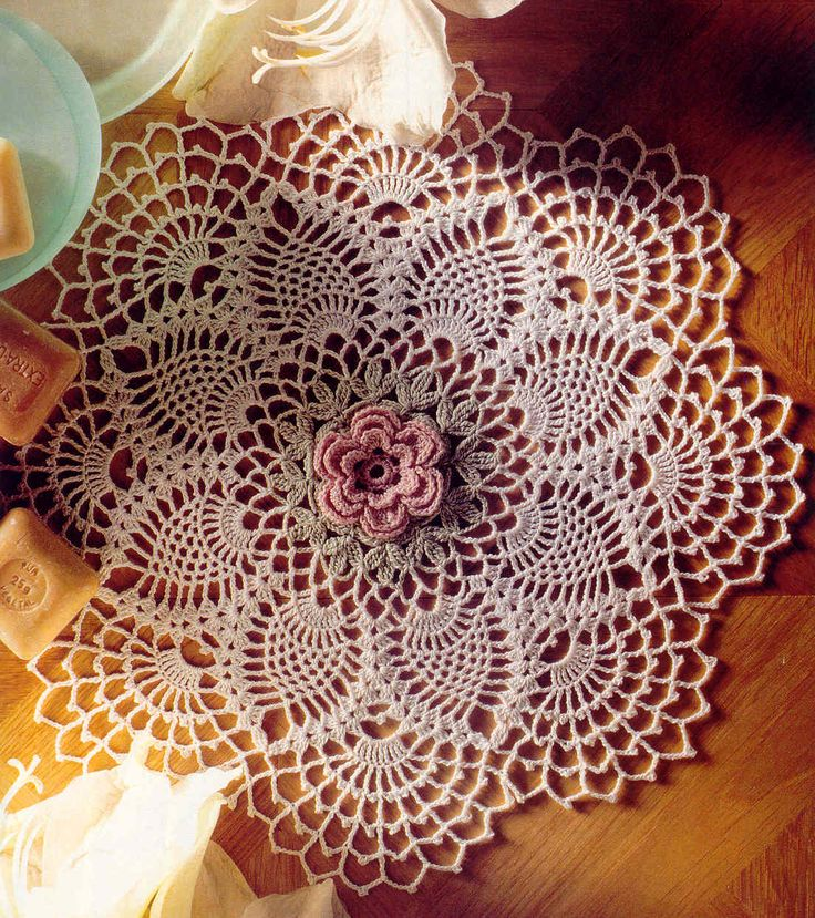 Doily with floral centrepiece. Free diagrammatic instructions for this lovely piece of crochet.