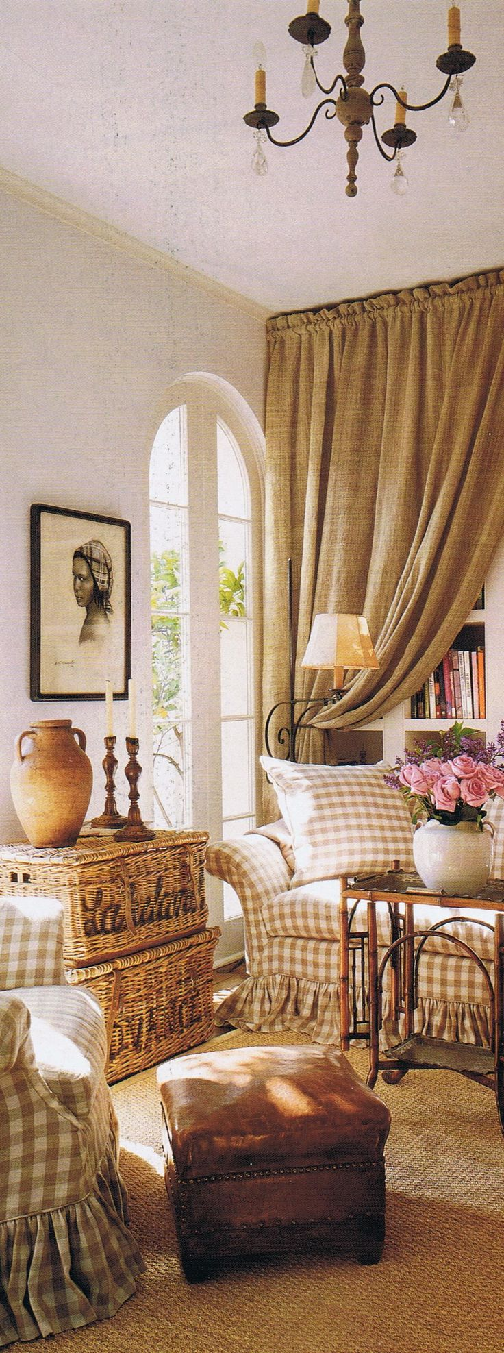 French Country Decor -  Taupe and white checkered furniture, complimented by wicker baskets, burlap curtains & ottoman. Classic French Country Style by Pam Pierce.
