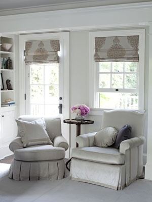 Love the window treatments. Also, maybe I should put two decorative chairs (smaller than these probably -- maybe ones with no armrests) with a small pedestal table in between in the corner of the living room next to the fireplace! How cozy that would be.