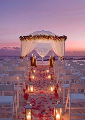 Sunset Beach Wedding. GORGEOUS! THIS is what I want as my wedding. Everything about it is perfect, following with the lighting of balloon lanterns being released...Oh my. via Kristin Anne
