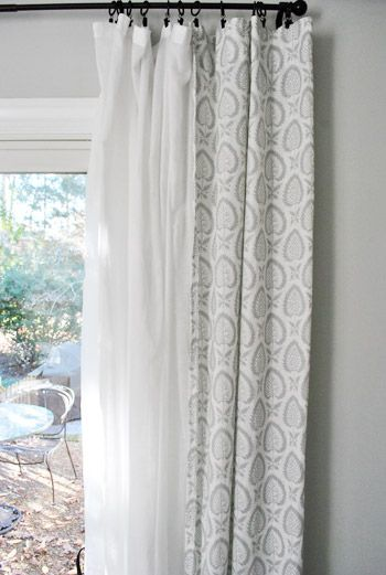 Sheer with design overlay. Beautiful idea for patio door - as the main source of natural light in the living room, these curtains wouldn't ever be closed.