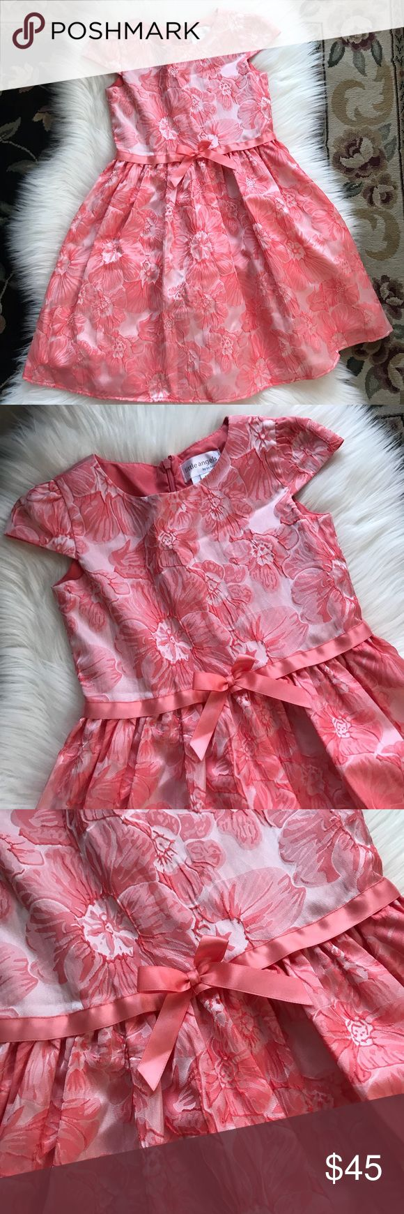 "US Angels Girls Flower Print Dress Size 7 Little Angels by US Angels Peach Color Flower Print Girls Dress Size 7.  100% Polyester. Worn once. Back zipper. Ties in the back. 27"" approximately Shoulder to hem. Formal dress. Party dress. Us Angels Dresses"