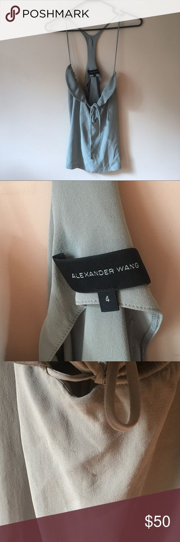 alexander wang racerback tank silk crepe tank top with a dry hand feel in a light gray color. there is a peter pan collar at the neck with hanging ties and the fit is loose and flowy.  this top needs a little tlc to bring it back to life but it's so cute I️ think it's worth it! the collar is slightly rotated and needs to be ironed or steam pressed back in placed and there is also a small stain on the front (pictured) in most positions, the hanging ties cover the stain but I️ priced this low…
