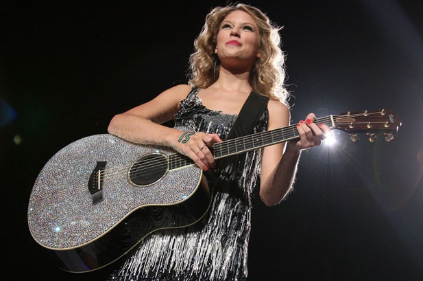 I love her sparkly guitar!
