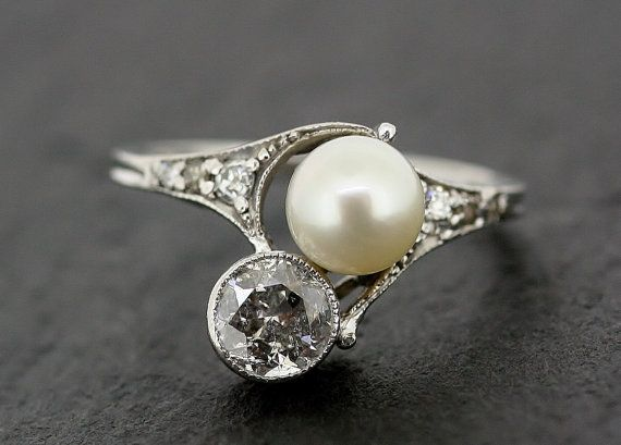 a vintage diamond and pearl ring.