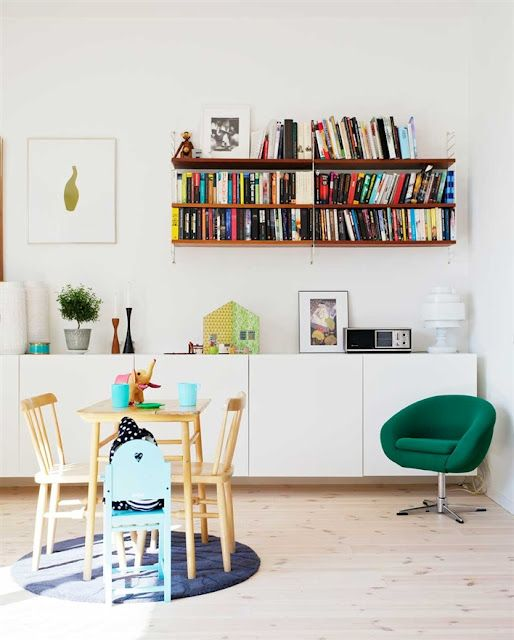 I'd like to have a low, white cabinet like this along the dining room wall.  An Ikea Besta perhaps?