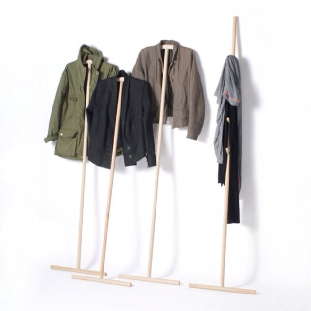 """The Kleiderstiele (German for """"clothing sticks"""") are minimal and clever leaning clothing racks. Designed by Johanna Dehio for Raumgestal, the pieces pose an alternative to the traditional clothing storage arrangements. Light, thin and easily movable, the Kleiderstiele can be stored when not in use and offered to a guest or a party of guests in seconds. The collection includes three hanger sticks of different height and one, equipped with hooks for scarves, hats and handbags. And thanks to…"""