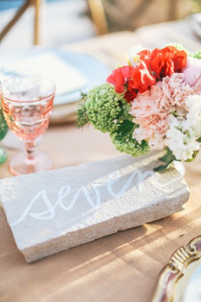 Stone table numbers: http://www.stylemepretty.com/2013/10/29/malibu-wedding-from-max-wanger-bash-please/ | Photography: Max Wanger - http://maxandfriends.com/