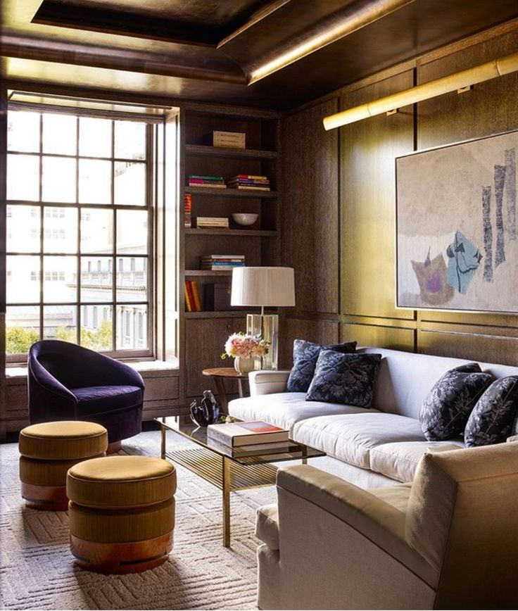 Moody contemporary living room with metallic accents and jewel tones