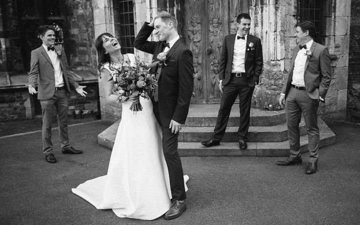 Bride laughing at groom at Berkeley Castle wedding, Gloucestershire