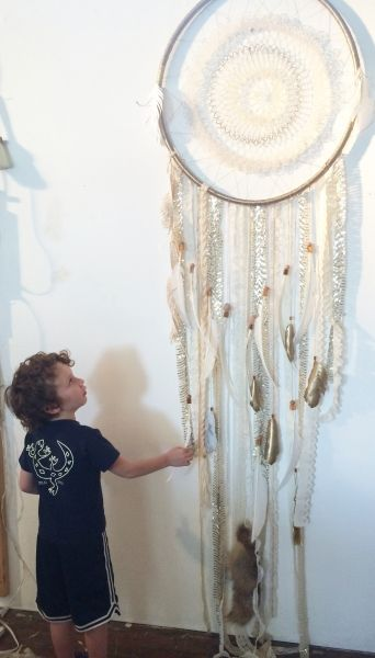 gold-sparkly-dreamcatcher-with-child-rachaelrice