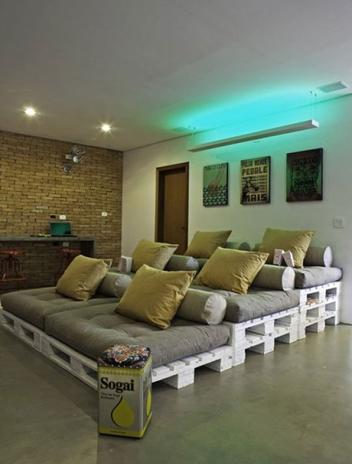 Media room built with amphitheater style wood pallet seats