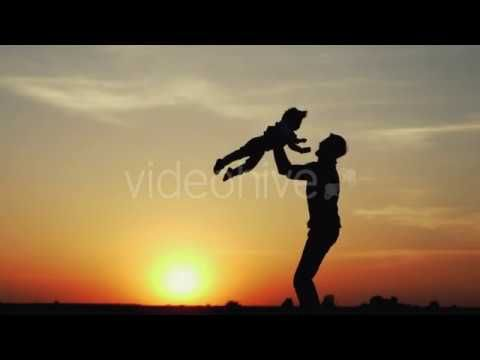 Happy Child Rushes into Hands of Father (Stock Footage)